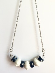 White and navy acrylic and ceramic beaded necklace by Marjorie Henderson.